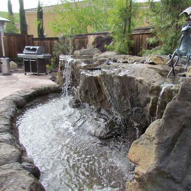 Backyard water features pond waterfalls swimming pool for Backyard ponds and water features