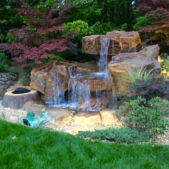 Backyard water features pond waterfalls swimming pool for Small pond water feature