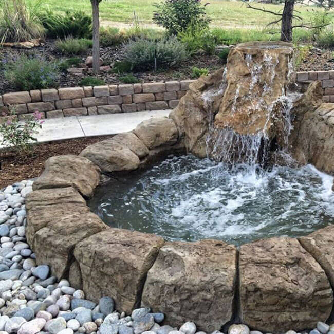 Backyard water features pond waterfalls swimming pool for Stone garden waterfall